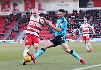 Lewis Coyle of Fleetwood Town challenges for the ball against Luke McCullough of Doncaster Rovers during the Sky Bet League 1 match between Doncaster Rovers and Fleetwood Town at the Keepmoat Stadium, Doncaster, England on 17 February 2018. Photo by Leila Coker / PRiME Media Images.