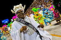 King Momo performs during the Carnival parade at the Sambadrome in Rio de Janeiro, Brazil, 20 February 2012. The Carnival in Rio de Janeiro, considered the biggest carnival in the world, is a colorful, four day celebration, taking place every year forty days before Easter. The Samba school parades, featuring thousands of dancers, imaginative costumes and elaborate floats, are held on the Sambadrome, a purpose-built stadium in downtown Rio. According to costumes, flow, theme, band music quality and performance, a single school is declared the winner of the competition.
