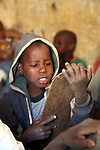 Pupils in a coranic school in Timbuctu, Mali, are learning by heart the versets of Coran written on wooden boards. The coranic schools in Timbuctu are only open early in the morning and on Saturdays in order to allow pupils to attend the public school.