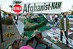 Dec. 2, 2009 -- PHOENIX, AZ: People opposed to the US military involvement in Afghanistan picket on a street corner in Phoenix, AZ, Wednesday. About 50 people from across the Phoenix metropolitan area attended the protest and vigil against the troop increase President Barack Obama announced on Dec. 1. Photo by Jack Kurtz