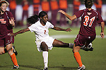 05 November 2008: Florida State's Jessica Price (2) and Virginia Tech's Kim Hickey (21) challenge for the ball. Virginia Tech and Florida State University played to a 0-0 tie after two overtimes at Koka Booth Stadium at WakeMed Soccer Park in Cary, NC in a women's ACC tournament quarterfinal game.  Virginia Tech advanced to the semifinal round in penalty kicks, 4-2.