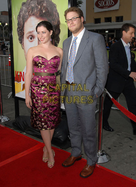 "SETH ROGEN & GUEST.The Universal Pictures' World Premiere of ""Knocked Up"" held at The Mann's Village Theatre in Westwood, California, USA..May 21th, 2007.full length grey gray suit purple dress strapless ribbon bow .CAP/DVS.©Debbie VanStory/Capital Pictures"