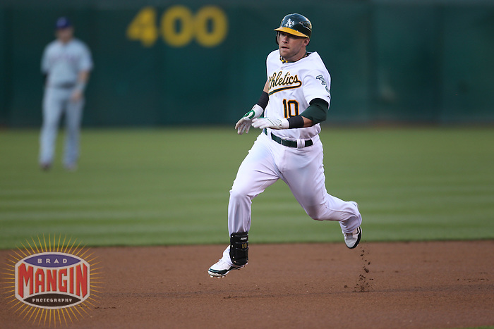 OAKLAND, CA - AUGUST 6:  Daric Barton of the Oakland Athletics runs the bases against the Texas Rangers during the game at the Oakland-Alameda County Coliseum on August 6, 2010 in Oakland, California. Photo by Brad Mangin