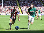 Billy Sharp of Sheffield Utd in action with Andreas Bjelland of Brentford during the English championship league match at Bramall Lane Stadium, Sheffield. Picture date 5th August 2017. Picture credit should read: Jamie Tyerman/Sportimage