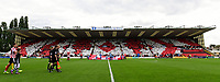 Lincoln City's Alex Woodyard leads his side out in front of a backdrop of a display by fans in the Lincolnshire Co-operative Stand <br /> <br /> Photographer Chris Vaughan/CameraSport<br /> <br /> The EFL Sky Bet League Two - Lincoln City v Morecambe - Saturday August 12th 2017 - Sincil Bank - Lincoln<br /> <br /> World Copyright &copy; 2017 CameraSport. All rights reserved. 43 Linden Ave. Countesthorpe. Leicester. England. LE8 5PG - Tel: +44 (0) 116 277 4147 - admin@camerasport.com - www.camerasport.com