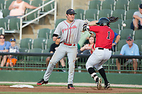 Alex Call (1) of the Kannapolis Intimidators tries to avoid a collision with Greenville Drive first baseman Tucker Tubbs (33) as he reaches for a throw at Kannapolis Intimidators Stadium on August 9, 2017 in Kannapolis, North Carolina.  The Drive defeated the Intimidators 6-1.  (Brian Westerholt/Four Seam Images)