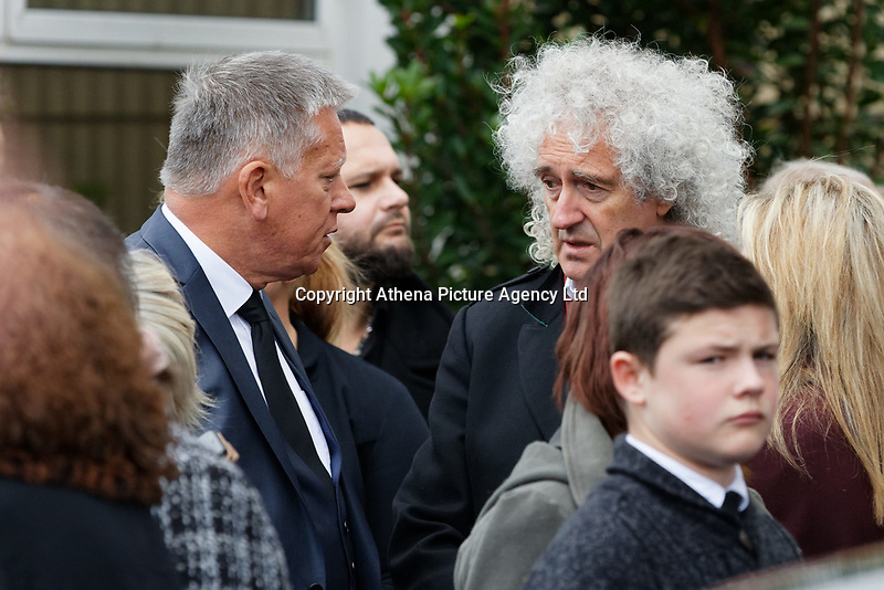 """Pictured: Brian May of The Queen (R) attends the service at Aberavon Beach Hotel in Port Talbot, Wales, UK. Monday 08 October 218<br /> Re: A grieving father will mourners on horseback at the funeral of his """"wonderful"""" son who killed himself after being bullied at school.<br /> Talented young horse rider Bradley John, 14, was found hanged in the school toilets by his younger sister Danielle.<br /> Their father, farmer Byron John, 53, asked the local riding community to wear their smart hunting gear at Bradley's funeral.<br /> Police are investigating Bradley's death at the 500-pupils St John Lloyd Roman Catholic school in Llanelli, South Wales.<br /> Bradley's family claim he had been bullied for two years after being diagnosed with Attention Deficit Hyperactivity Disorder.<br /> He went missing during lessons and was found in the toilet cubicle by his sister Danielle, 12."""