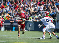 Washington, DC - March 31, 2018: Denver Pioneers Ted Sullivan (33) keeps the ball away from Georgetown Hoyas Greg Galligan (28) during game between Denver and Georgetown at  Cooper Field in Washington, DC.   (Photo by Elliott Brown/Media Images International)