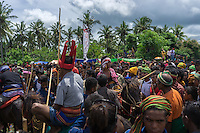 March 26, 2016 - Ratenggaro (Indonesia). A rider who just got hit by a spear in the head , is surrounded by members of his clan. The festival can be really dangerous for its participants and fatal injuries still do occurs.  Furthermore, Sumbanese believe that blood will fertilize the land and produce a better harvest. © Thomas Cristofoletti / Ruom