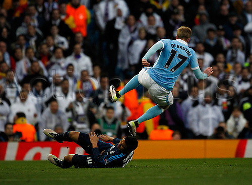 26.04.2016. The Etihad, Manchester, England. UEFA Champions League. Manchester City versus Real Madrid. Manchester City's Belgian midfielder Kevin de Bruyne jumps over the tackle of Real Madrid midfielder Casemiro.