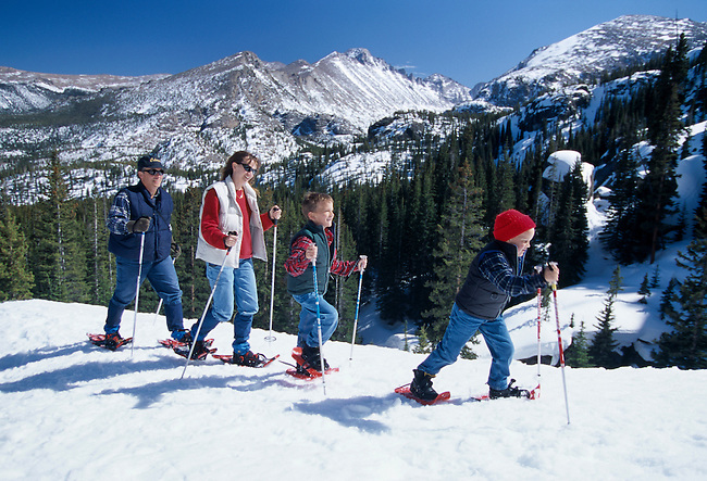 Family having fun while snowshoeing in Rocky Mtn Nat'l Park, CO