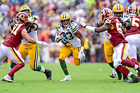 Landover, MD - September 23, 2018: Green Bay Packers running back Aaron Jones (33) runs the football up the middle for a first down during game between the Green Bay Packers and the Washington Redskins at FedEx Field in Landover, MD. The Redskins get the win 31-17 over the visiting Packers. (Photo by Phillip Peters/Media Images International)