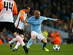 David Silva of Manchester City tackled by Bernard of Shaktar Donetsk during the Champions League Group F match at the Emirates Stadium, Manchester. Picture date: September 26th 2017. Picture credit should read: Andrew Yates/Sportimage