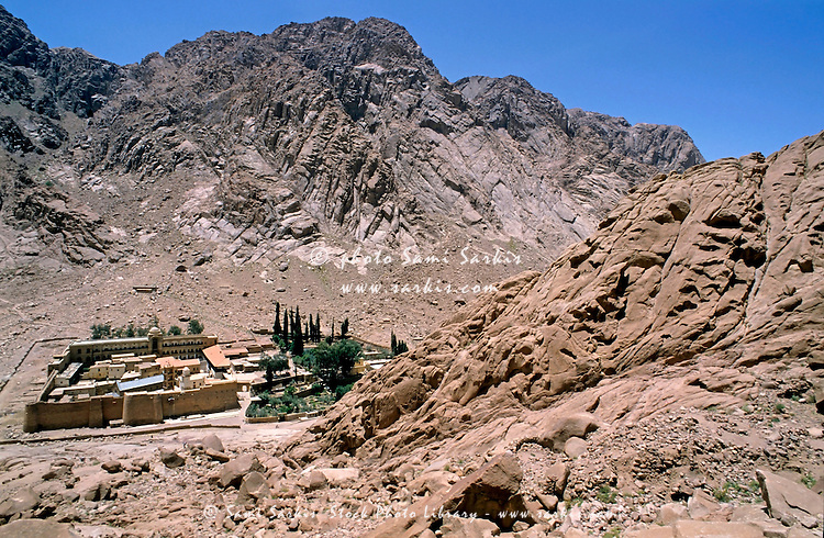 Rocky cliffs surrounding the buildings of Saint Catherine's Monastery, Mt Sinai, Egypt.