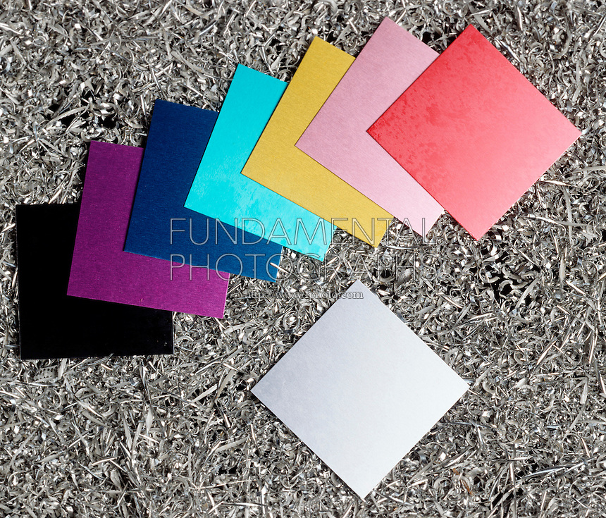 ANODIZED ALUMINUM SHEETS<br /> On a bed of aluminum shavings.<br /> Sheets are given a thick oxide coating which is porous enough to hold printing inks that would not stick to aluminum under normal oxidation.