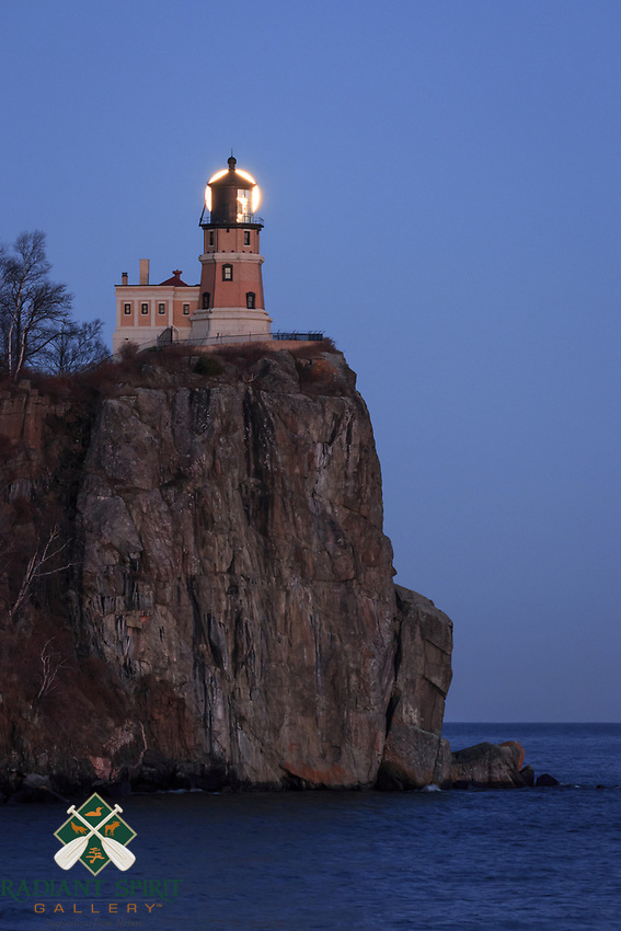&quot;Lunar Light&quot;<br /> <br /> The December (near) full Cold Moon rose through a pastel palette on the eve of the Supermoon. Split Rock Lighthouse and Lake Superior helped paint a serene scene for the event. As it gained altitude, the moon appeared perfectly behind the lens of the lighthouse.