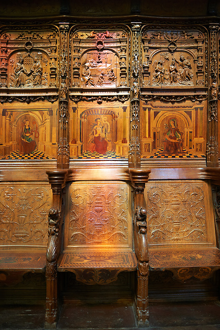 16th century  Renaissance Gothic style stalls with wood sculptures & inlays ordered by cardinal Georges d'Ambrose of Rouen. The Gothic Cathedral Basilica of Saint Denis ( Basilique Saint-Denis ) Paris, France.  A UNESCO World Heritage Site.