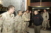 United States Secretary of Defense Donald H. Rumsfeld meets with soldiers from the 1st Brigade, 25th Infantry Division while at, Mosul, Iraq, December 24, 2004. Rumsfeld traveled to Iraq to show is support to service members and visit patients and staff from the 67th Combat Surgical Hospital. <br /> Mandatory Credit: James M. Bowman / DoD via CNP