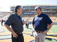 California head coach Sonny Dykes talks with Washington State head coach Mike Leach before the game at Memorial Stadium in Berkeley, California on October 5th, 2013.  Washington State defeated California, 44-22.