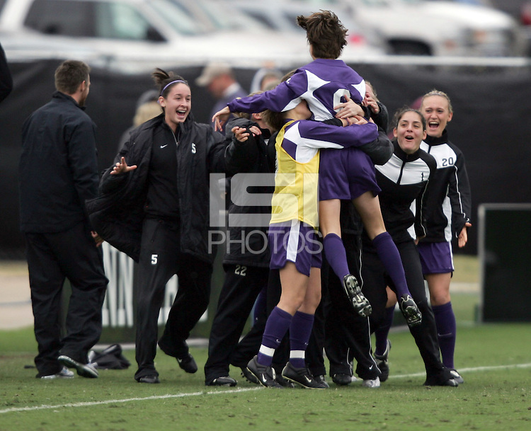 After scoring the first goal, Portland's Angie Woznuk (6) raced the length of the field and jumped on her teammates on the bench. The University of Portland Pilots led the UCLA Bruins 3-0 at halftime in the NCAA Division I Women's Soccer Championship game at Aggie Soccer Stadium in College Station, TX, Sunday, December 4, 2005.