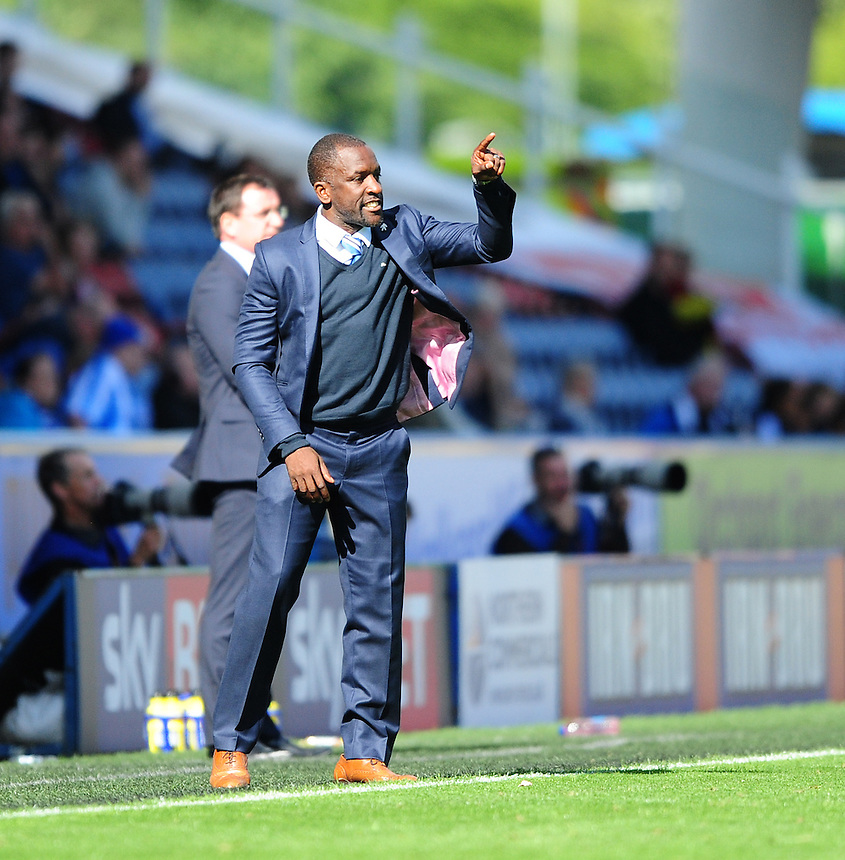 Huddersfield Town manager Chris Powell shouts instructions to his team from the dug-out<br /> <br /> Photographer Chris Vaughan/CameraSport<br /> <br /> Football - The Football League Sky Bet Championship - Huddersfield Town v Blackburn Rovers - Saturday 15th August 2015 - The John Smith's Stadium - Huddersfield<br /> <br /> &copy; CameraSport - 43 Linden Ave. Countesthorpe. Leicester. England. LE8 5PG - Tel: +44 (0) 116 277 4147 - admin@camerasport.com - www.camerasport.com