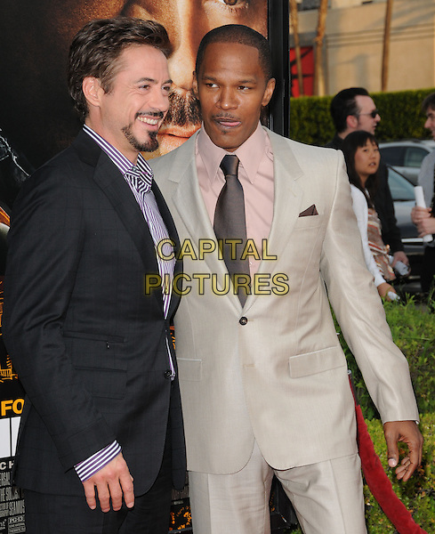 "ROBERT DOWNEY JR. & JAMIE FOXX .L.A. Premiere of ""The Soloist"" held at Paramount Studios in Hollywood, California, USA..April 20th, 2009.half length black beige suit jacket purple striped stripes shirt goatee facial hair profile brown tie tongue funny face  .CAP/DVS.©Debbie VanStory/Capital Pictures."