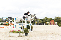 Female rider jumping fence, at jumping competition.<br /> Czech Equestrian Masters 2017 held at Equitana Martinice, The Czech Republic