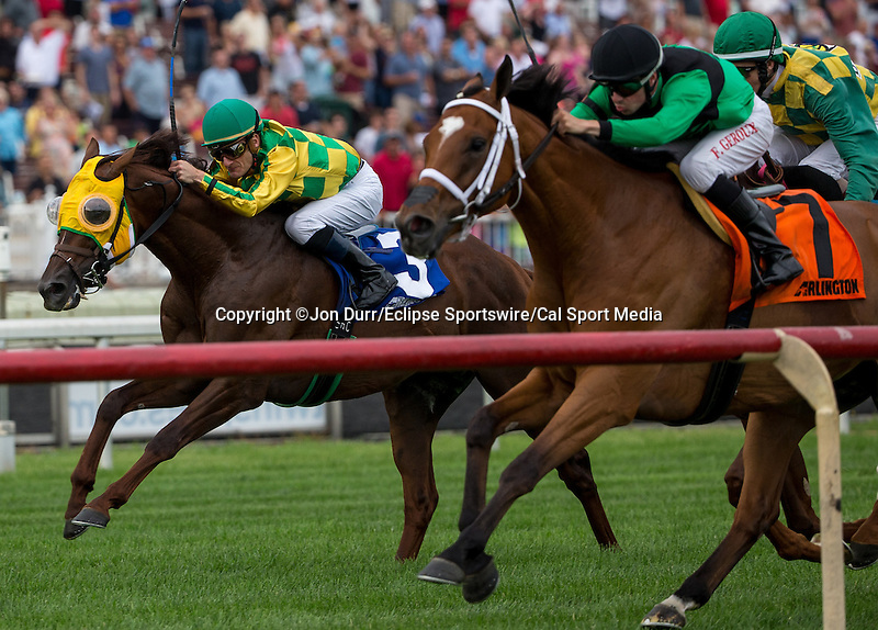 APRIL 12, 2014: Suntracer, ridden by Julien R. Leparoux (left), and The Pizza Man, ridden by Florent Geroux, on the home stretch in the Stars and Stripes Stakes on Arlington Million Preview Day at Arlington Racetrack in Arlington Heights, IL. Jon Durr/ESW/Cal Sport Media