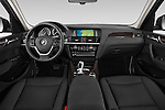 Stock photo of straight dashboard view of 2017 BMW X3 sDrive28i 5 Door SUV Dashboard