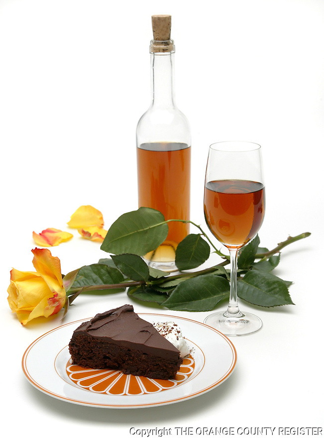 Single piece of a 'Queen of Shiba' cake served with glass of Vin Santo. Portfolio only.