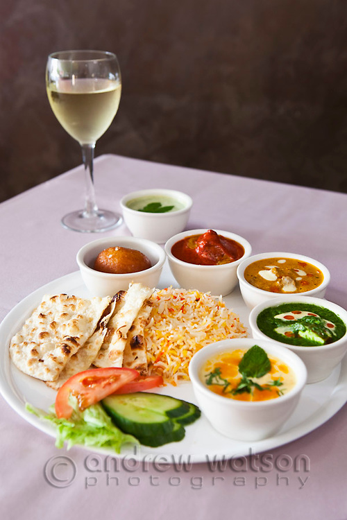 Selection of Indian curries and tandoori chicken.