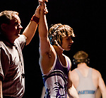 Referee Dennis White raises the arm of Spanish Springs Rito Hernandez after he defeated North Valley's Mickey Castonguay in the 132 pound weight class during the Division 1 NIAA Region Wrestling  Championship on Saturday afternoon, February 2, 2013 at Reno High School.