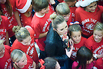 "Miley Cyrus is surrounded by young volunteers at the Sharing the Spirit Holiday Party held for Orange County's shelter and motel kids at South Coast Plaza on Friday night. ""I don't just stop at one thing that's important to me,"" she told the kids in urging them to keep volunteering to help others in their communities. ""Whatever makes you happy, that's what you give."""