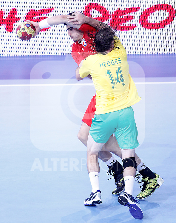 Croatia's Luka Stepancic (l) and Australia's Mitchell Hedges during 23rd Men's Handball World Championship preliminary round match.January 12 ,2013. (ALTERPHOTOS/Acero)
