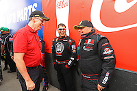 Feb 26, 2017; Chandler, AZ, USA; NHRA president Peter Clifford (left) talks with top fuel driver Scott Palmer (right) and Shawn Reed during the Arizona Nationals at Wild Horse Pass Motorsports Park. Mandatory Credit: Mark J. Rebilas-USA TODAY Sports