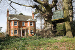 Large detached Victorian or Edwardian house viewed from garden with daffodils and children's play equipment, Great Bealings, Suffolk