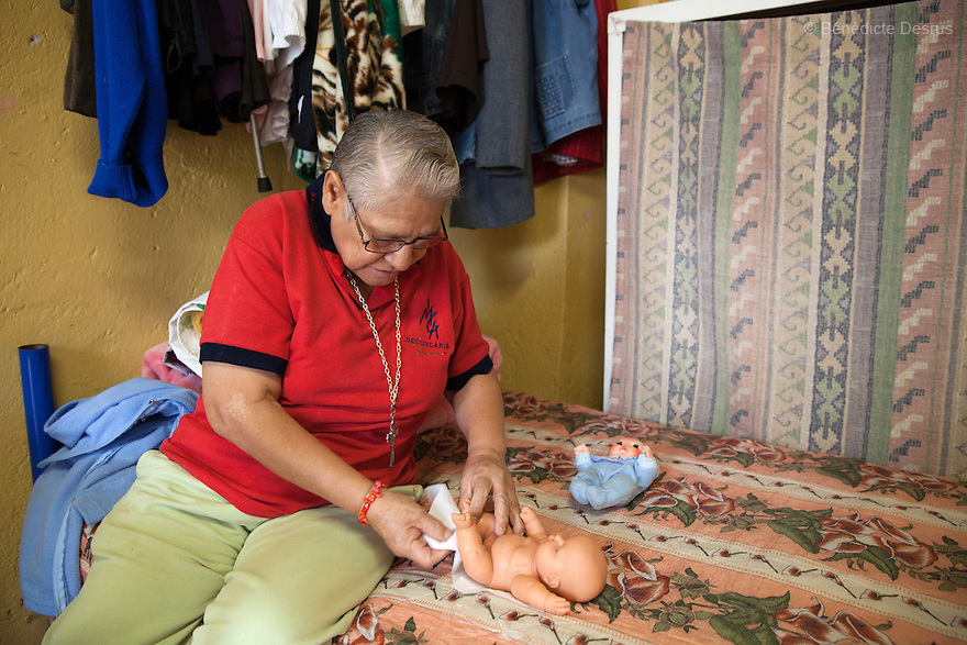 Elia, a resident of Casa Xochiquetzal, talks to her dolls as a method of coping with her past life, in her bedroom at the shelter in Mexico City, Mexico on June 8, 2016. Casa Xochiquetzal is a shelter for elderly sex workers in Mexico City. It gives the women refuge, food, health services, a space to learn about their human rights and courses to help them rediscover their self-confidence and deal with traumatic aspects of their lives. Casa Xochiquetzal provides a space to age with dignity for a group of vulnerable women who are often invisible to society at large. It is the only such shelter existing in Latin America. Photo by Bénédicte Desrus