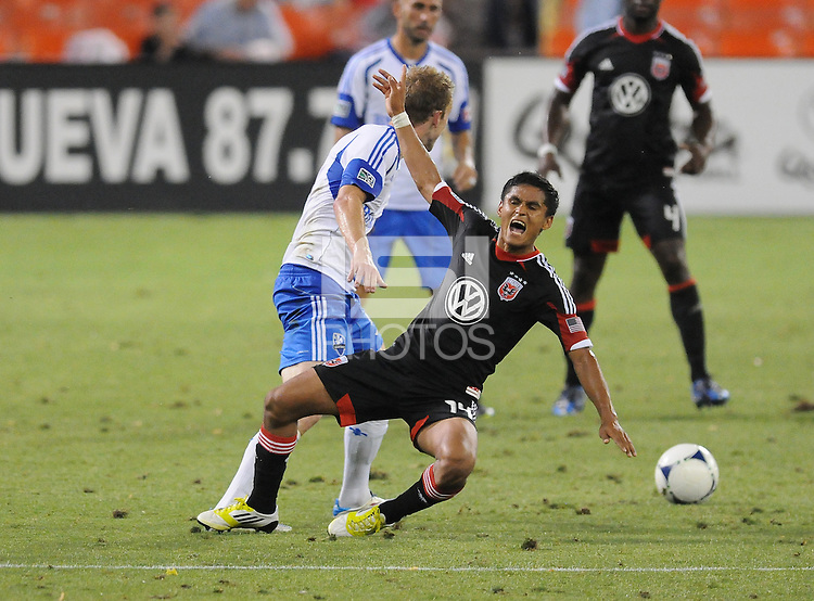 D.C. United midfielder Andy Najar (14) gets fouled by Montreal Impact defender Tyson Wahl (5) D.C. United defeated Montreal Impact 3-0 at RFK Stadium, Saturday June 30, 2012.