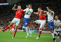 (L-R) Adam Matthews of Wales, Luka Milivojevic of Serbia Sam Vokes of Wales and Aleksandar Mitrovic of Serbia jump for a header from a Wales corner kick during the 2018 FIFA World Cup Qualifier between Wales and Serbia at the Cardiff City Stadium, Wales, UK. Saturday 12 November 2016