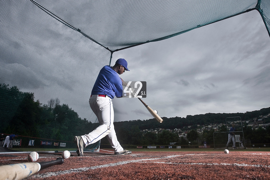 14 July 2010: Unidentified player makes contact in the batting cage during day 2 of the Open de Rouen, an international tournament with Team France, Team Saint Martin, Team All Star Elite, at Stade Pierre Rolland, in Rouen, France.