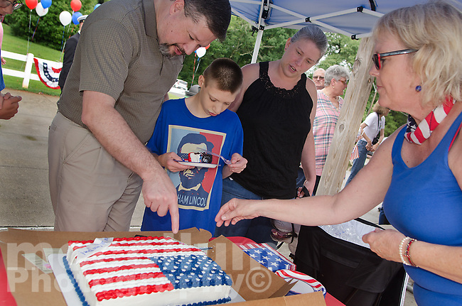 """Michael McCollum<br /> 8/2/18<br /> Ryan interacts with friends and family at the reveal ceremony where it was announced to 13 year old Ryan Overman of west Knoxville that The Wish Connection is granting Ryan's wish to go to Washington DC and visit the White House at Carl Cowan Park, 10058 S Northshore Dr, Knoxville, TN, Thursday, August 2, 2018 at 5:45pm. Approximately 50-60 people attended, including the Overman family, friends, and AT&T Employees. The Bearden High School Cadets also attended and lead the pledge of allegiance.<br /> The AT&T Wish Connection is going to send Ryan, his family, and his service dog to Washington DC and while they are gone, the group of volunteers will be doing a makeover on his bedroom and turn it into the """"Oval Office"""" at the White House.<br /> Ryan was born two weeks prematurely on May 13, 2005. During the pregnancy he was classified as high risk due to a measured lack of growth and, after a brief stay in the hospital, he came home weighing only 4 lbs 5 oz. His development was much slower compared to his peers, such as not learning to walk until he was well over a year old, and he was much smaller. The Overman family worked with Tennessee Early Intervention Services (TEIS) when Ryan was about one year old and with their help they were able to get Ryan enrolled through TEIS to receive Occupational, Physical, and Speech Therapy. When Ryan turned three he transitioned from TEIS to the Knox County Early Intervention Program and began attending a special school to continue his therapies until he was old enough to enroll at Cedar Bluff Elementary and now is at Cedar Bluff Middle School. In 2016, Ryan was diagnosed to have retinitis pigmentosa, a degenerative disease of the retinas that under the best of circumstances causes severe tunnel vision, but more commonly results in complete blindness.<br /> Despite the physical difficulties that Ryan has had to endure over the last thirteen years, he continually brightens the lives of those aroun"""