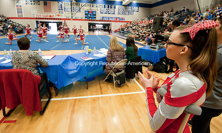 WATERBURY CT--- -022016JS09- Sam Welch, a junior at Wolcott High School, watches her her team competes during the NVL Cheerleading Championships held Saturday at Crosby High School in Waterbury. Welch injured her ankle earlier in the year and was unable to compete. <br />   Jim Shannon Republican-American
