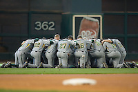 The Baylor Bears huddle in left field prior to taking on the UCLA Bruins in the 2009 Houston College Classic at Minute Maid Park February 28, 2009 in Houston, TX.  The Bears defeated the Bruins 5-1. (Photo by Brian Westerholt / Four Seam Images)
