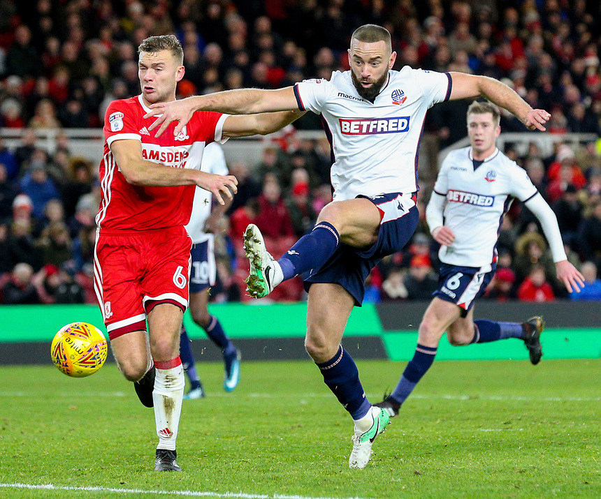 Bolton Wanderers' Aaron Wilbraham can't quite connect with a cross under pressure from Middlesbrough's Ben Gibson<br /> <br /> Photographer Alex Dodd/CameraSport<br /> <br /> The EFL Sky Bet Championship - Middlesbrough v Bolton Wanderers - Tuesday 26th December 2017 - Riverside Stadium - Middlesbrough<br /> <br /> World Copyright &copy; 2017 CameraSport. All rights reserved. 43 Linden Ave. Countesthorpe. Leicester. England. LE8 5PG - Tel: +44 (0) 116 277 4147 - admin@camerasport.com - www.camerasport.com