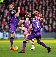 Lincoln City's Bruno Andrade vies for possession with Port Vale's Antony Kay, left, and James Gibbons<br /> <br /> Photographer Andrew Vaughan/CameraSport<br /> <br /> The EFL Sky Bet League Two - Lincoln City v Port Vale - Tuesday 1st January 2019 - Sincil Bank - Lincoln<br /> <br /> World Copyright &copy; 2019 CameraSport. All rights reserved. 43 Linden Ave. Countesthorpe. Leicester. England. LE8 5PG - Tel: +44 (0) 116 277 4147 - admin@camerasport.com - www.camerasport.com
