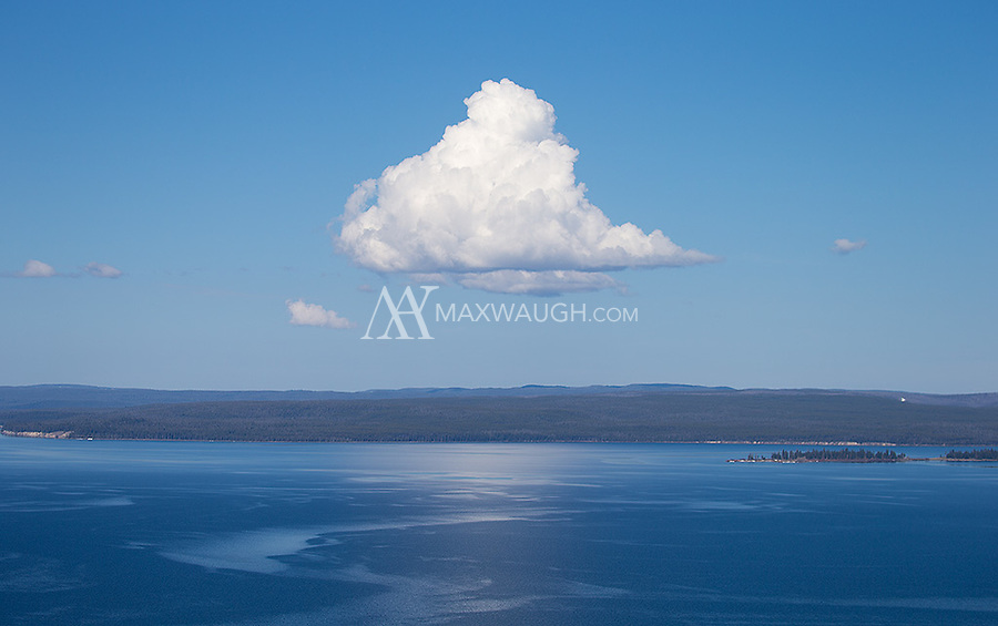A single cloud dominates the skyline above Yellowstone Lake.