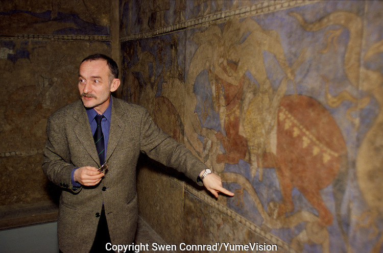 Grigori Semenov of the East Department of the Hermitage museum in St. Petersburg-Russia, explaining the Tajik fresco of Penjikent. According to Grigori Semenov In Tajikistan, President Rakmonov finds the classical period interesting, so there is some work on that. But the Bronze age, is not interesting to the President because there are no Turkmens.