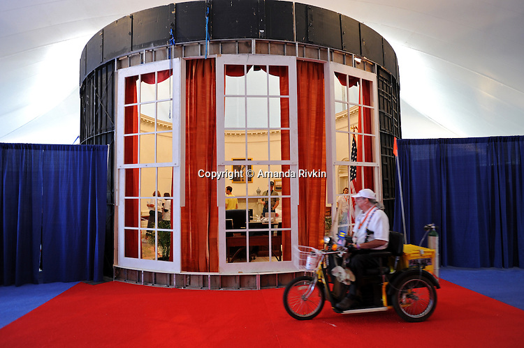 Locals and tourists visit an exhibit that includes a mock-up of the American President's Oval Office and other regalia of the American presidential experience at Invesco Field in Denver, Colorado on August 22, 2008.   The Democratic National Convention officially kicks off Monday August 25, 2008 at the nearby Pepsi Center.