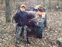 Courtesy photo<br /> FIRST DEER<br /> Grady Noblin, 7, of Springdale, shows his first deer, a 4-point buck, that he shot Nov. 7 during the statewide youth deer hunt. Grady is in the second grade at Shaw Elementary in Elm Springs. He was hunting with his dad, Barry, near Patrick in Madison County.