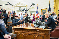 Kanye West, left, makes a statement to the media as he meets with United States President Donald J. Trump, right, and Jim Brown in the Oval Office of the White House in Washington, DC on Thursday, October 11, 2018.<br /> Credit: Ron Sachs / CNP /MediaPunch